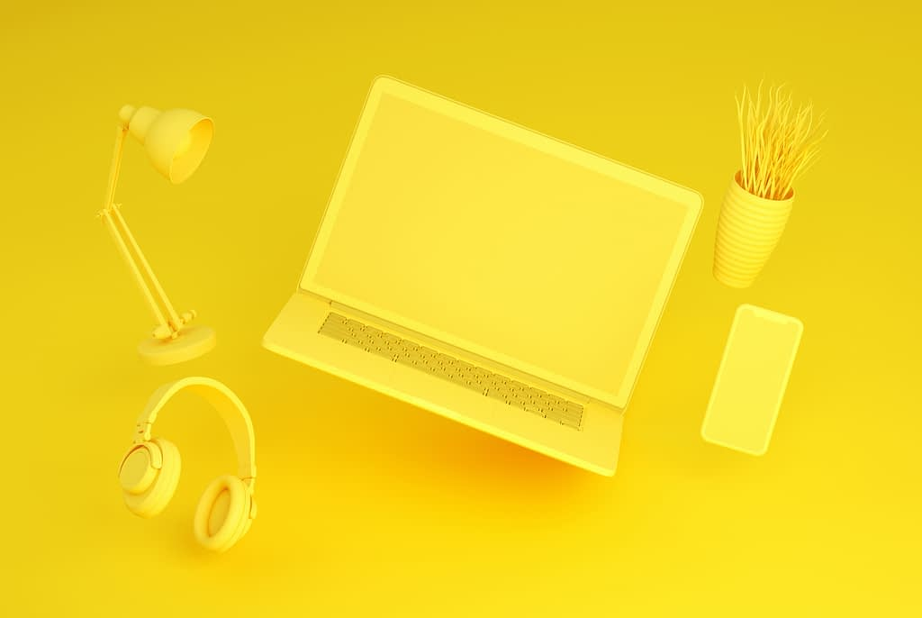 Flying Empty Screen Laptop and Smart Phone on Yellow Background, Zero Gravity